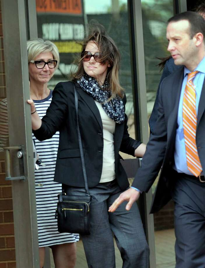 Kayla Mooney, center, leaves Danbury Superior Court with her attorney and supporters Monday morning, April 27, 2015. Mooney, a Danbury High School teacher, is charged with the sexual assault of a 17-year-old student. Photo: Carol Kaliff / Carol Kaliff / The News-Times