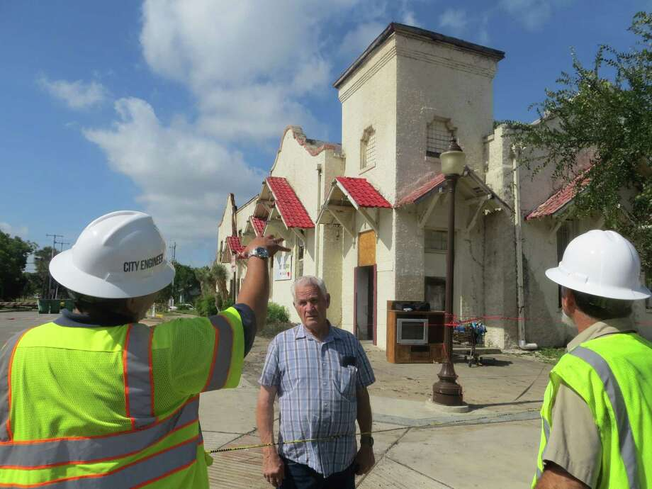 Pastor Don Crane (center) of Divine Fellowship Ministries in Seguin discusses the extent of damage to the church and food bank building from a July 6, 2016 fire with City Engineer Joe Ramos (left) and Seguin building official Gerald Bodin. Photo: Zeke MacCormack /Staff