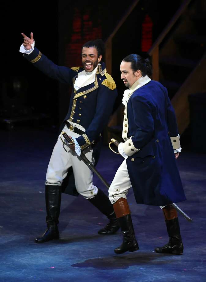"""File-This June 12, 2016, file photo shows Daveed Diggs, left, and Lin- Manuel Miranda, of """"Hamilton"""" performing at the Tony Awards at the Beacon Theatre in New York. Long before his life story became the toast of the Great White Way, Alexander Hamilton was a hit in Albany. The Times Union of Albany reports New York's capital is finally capitalizing on the """"Hamilton"""" Broadway musical craze with a lineup of attractions focusing on the founding father who got hitched in the upstate city and spent time in the area.(Photo by Evan Agostini/Invision/AP) Photo: Evan Agostini, Associated Press"""