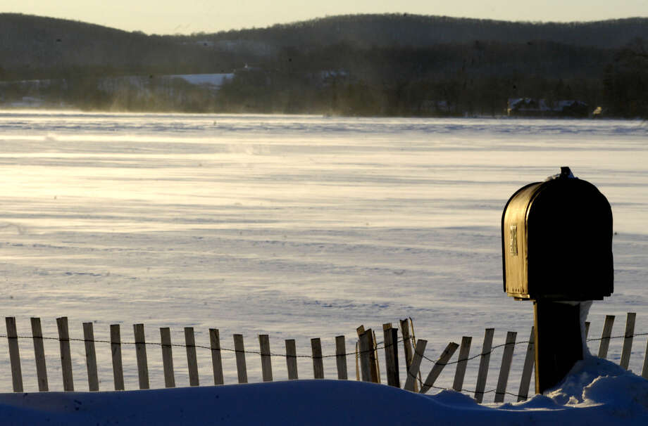 The golden light of sunset over Lake Waramaug lends a touch of warmth to an otherwise desolate, frigid mid-winter's scene along the Warren/Washington town line soon after last weekend's snowstorm . Feb. 9, 2013 Photo: Norm Cummings / Norm Cummings / The News-Times
