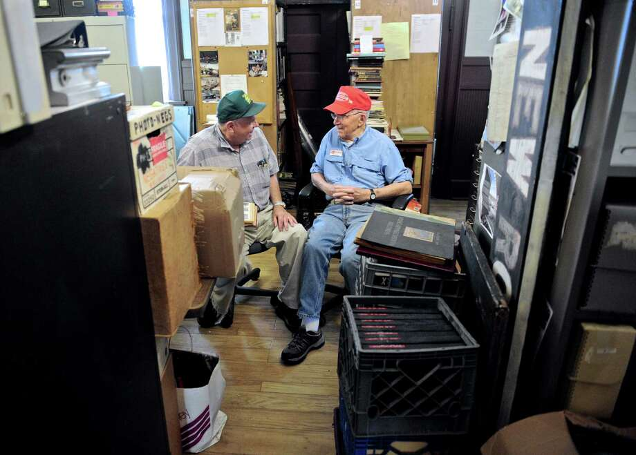 Peter McLachlan, of Newtown, left, and John O'Hern, of Danbury, sit in the archive room of the Danbury Railway Museum on White Street. McLachlan and O'Hern are volunteers at the museum.Thursday, July 7, 2016, in, Danbury, Conn. the archive room is full of railroad memorabilia that has been acquired or donated to the museum. Photo: H John Voorhees III / Hearst Connecticut Media / The News-Times