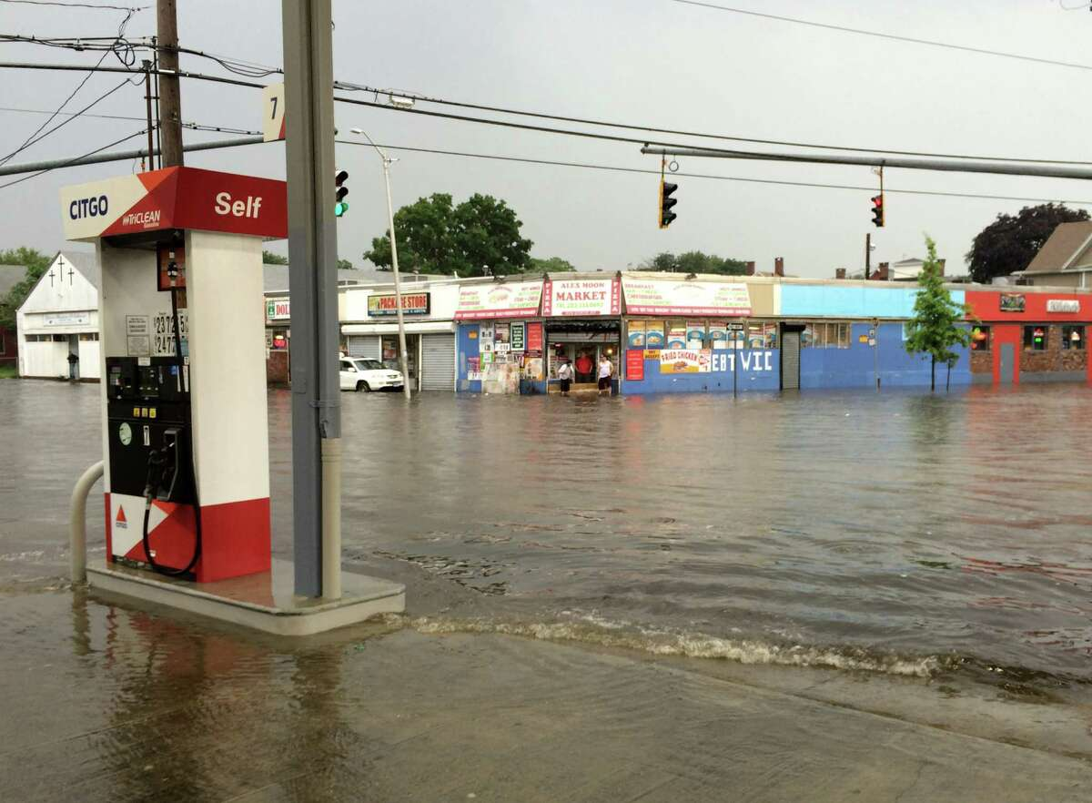 State Street and Iranistan Avenue in Bridgeport, Conn. flooded after heavy rain pounded the area on Thursday, July 7, 2016. Multiple reports of fallen trees and some flooding were recieved by police and fire services who scrambled to assist drivers.