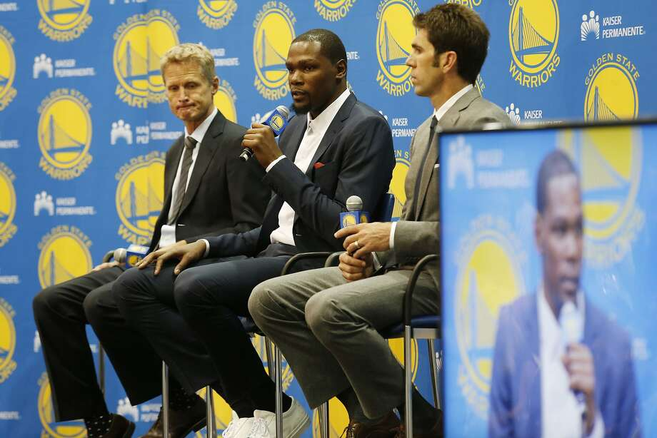Golden State Warriors' Kevin Durant, center, speaks as coach Steve Kerr, left and general manager Bob Myers listen during a news conference at the NBA basketball team's practice facility, Thursday, July 7, 2016, in Oakland, Calif. (AP Photo/Beck Diefenbach) Photo: Beck Diefenbach, Associated Press