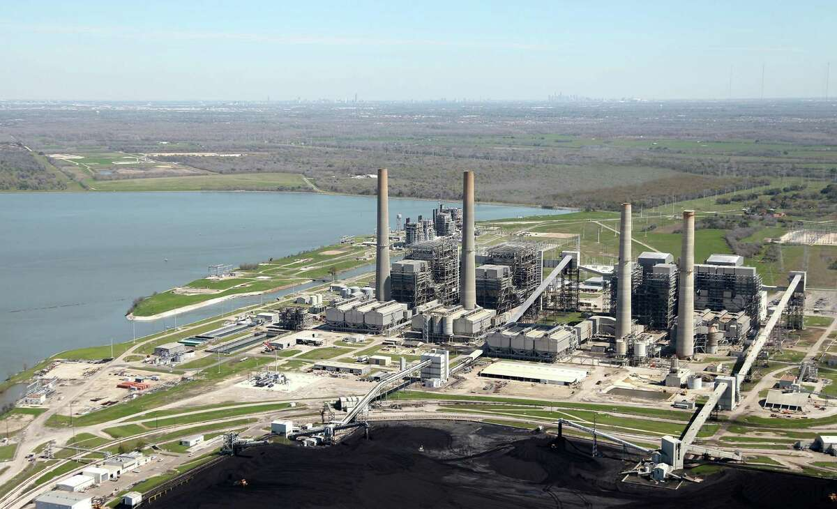 An aerial photo shows NRG Energy s W.A. Parish power plant in Fort Bend County, where the company began construction in 2014 on a $1 billion facility to capture the greenhouse gas carbon dioxide from one of the plant's coal-fired generation units. The gas, which otherwise would vent into the atmosphere, will be piped to an oil field for use in enhancing production. (NRG Energy photo)