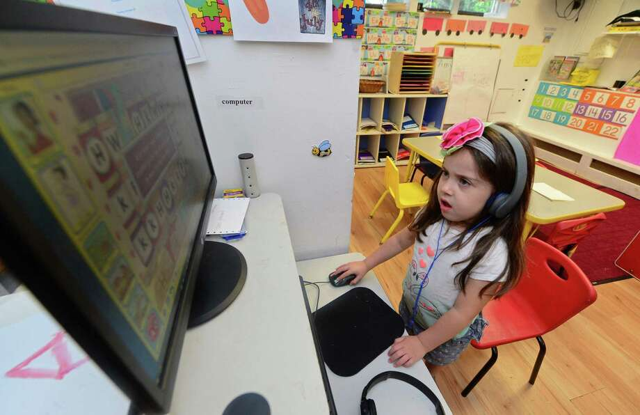 Thursday, July 7, 2016, at the School Readiness preschool for low income families, Children's Playhouse, on Bouton St. in Norwalk, Conn.In the new state budget, 7,200 children in CT will lose access to Care 4 Kids, which subsidizes low-income families for childcare services. Photo: Erik Trautmann / Hearst Connecticut Media