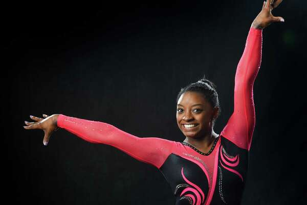 Simone Biles combines athleticism with exuberance in a way no current gymnast can match. MUST CREDIT: Washington Post photo by Jonathan Newton.