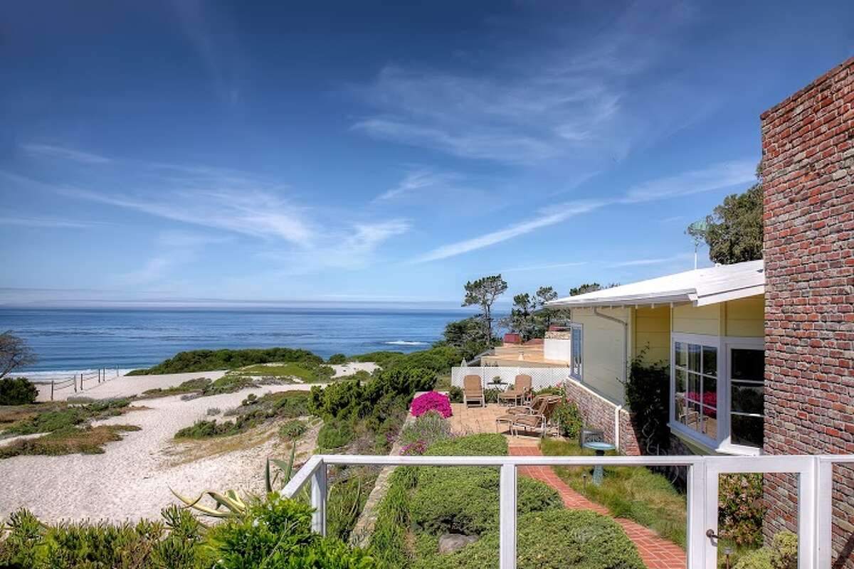 On the market for the first time in over 50 years, this three-bedroom home fronts the white sands of Carmel Beach and offers sweeping views of the Pacific. Sitting in a 10 acre beach preserve, this unique location is steps from Pebble Beach Golf links and a half block from the center of Carmel's Ocean Ave. On the market for $7.995 million.