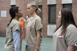 Taylor Schilling (center) and co-stars Jessica Pimentel and Jolene Purdy (Netflix) .