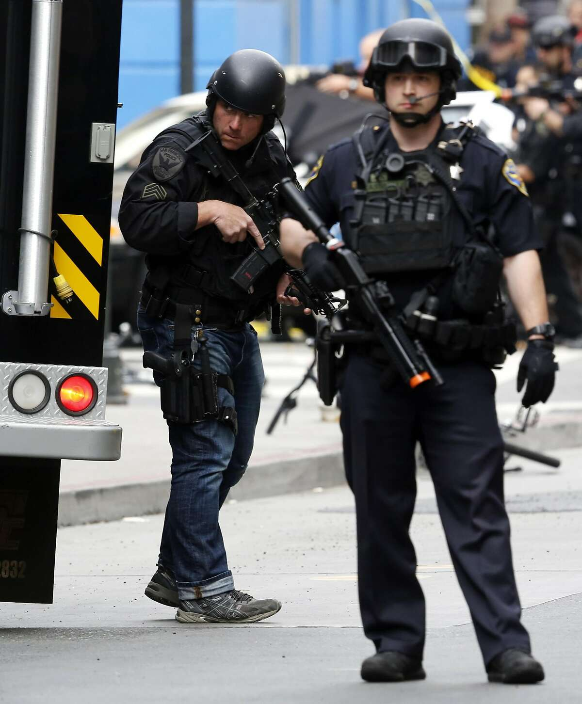 San Francisco Police Officers stay on alert during a standoff in San Francisco, California, on Wednesday, July 6, 2016.