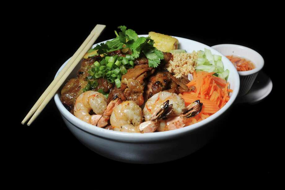 Vermicelli rice noodle bowl with grilled pork, shrimp and egg Photo: Billy Calzada /San Antonio Express-News / San Antonio Express-News