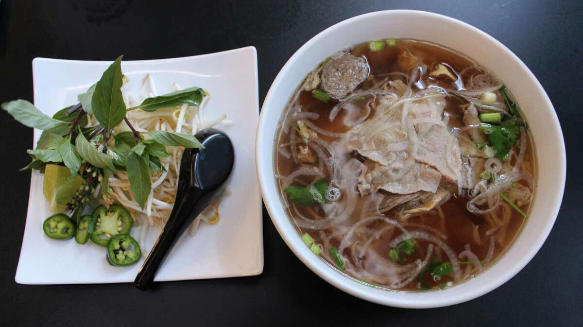 A special combination pho with beef noodle soup with eye round steak, brisket, rare flank, tendon, tripe and meatball
