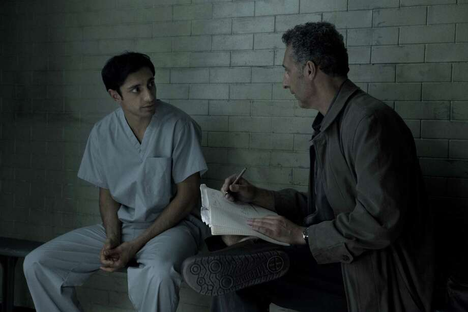 """Murder suspect Naz (Riz Ahmed) confers with attorney (John Turturro as John Stone) in HBO's murder drama """" The Night Of."""" In it, a youth falls, little by little, into a nightmarish case of homicide. Photo: Craig Blankenhorn / HBO"""