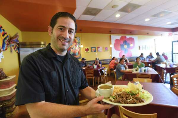 Javier Sanchez displays a plate of fajitas at Sazon Mexican Cafe, which has won the Readers' Choice for Best Mexican food.
