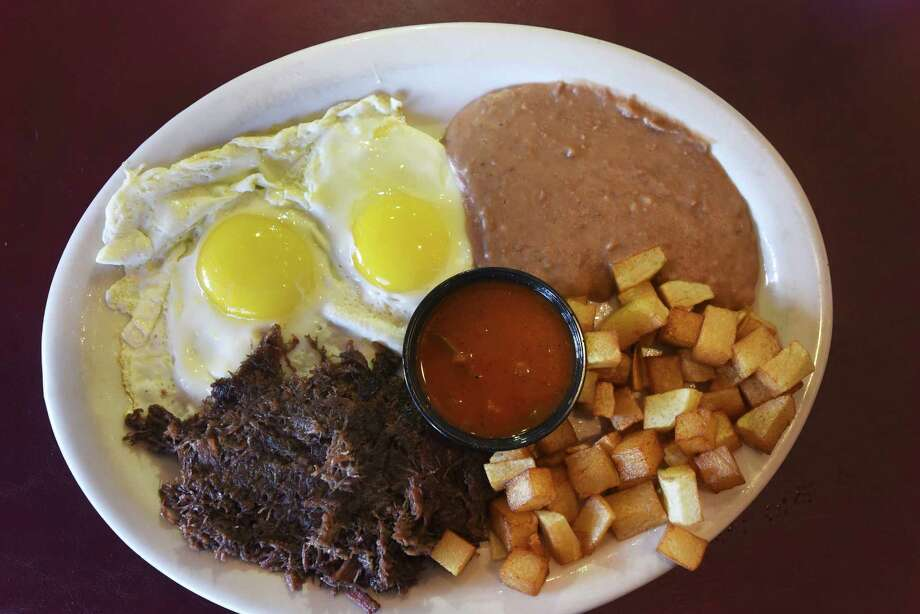 The barbacoa and eggs plate is a favorite at Sazon Mexican Cafe, which has won the Readers Choice for Best Mexican food. Photo: Billy Calzada /San Antonio Express-News / San Antonio Express-News