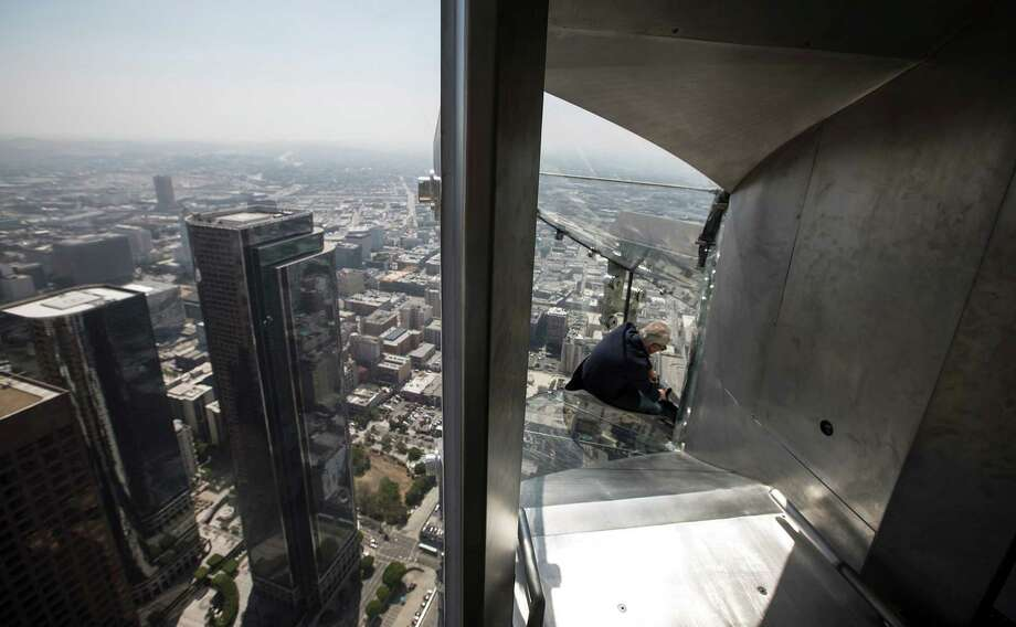 Members of the media take a four-second ride down the Skyslide at U.S. Bank Tower in Los Angeles during a media preview on June 23. Photo: Brian Van Der Brug /TNS / Los Angeles Times