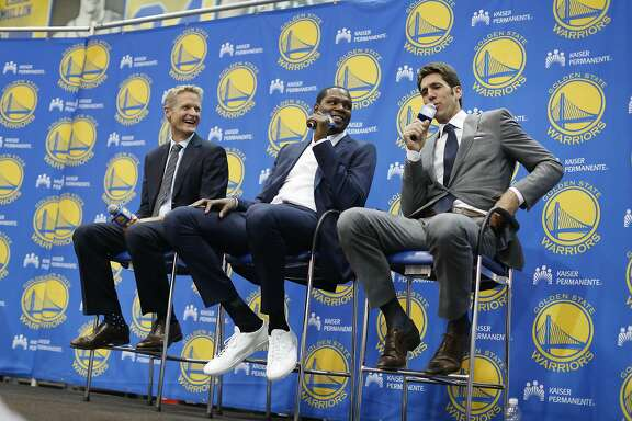 Bob Myers, (right) Warriors general manager, and Steve Kerr (second from left), Warriors head coach,  break into laughter as Kevin Durant (center) answers a question  during the introductory press conference for Durant  at the Warriors practice facility on Thursday, July 7, 2016 in Oakland, California.
