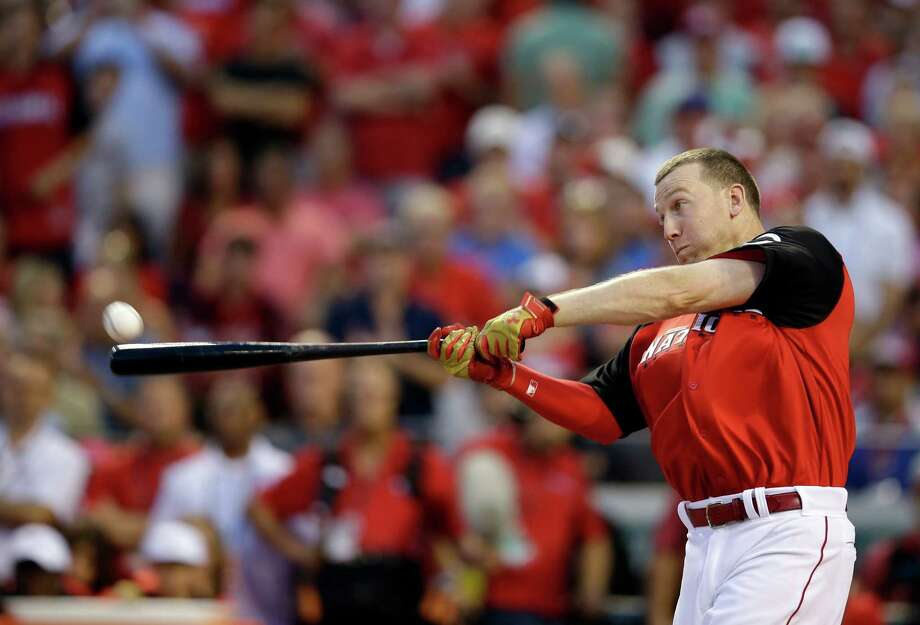 National League's Todd Frazier, of the Cincinnati Reds, hits during the MLB All-Star baseball Home Run Derby, Monday, July 13, 2015, in Cincinnati. (AP Photo/John Minchillo) Photo: John Minchillo, Associated Press / AP