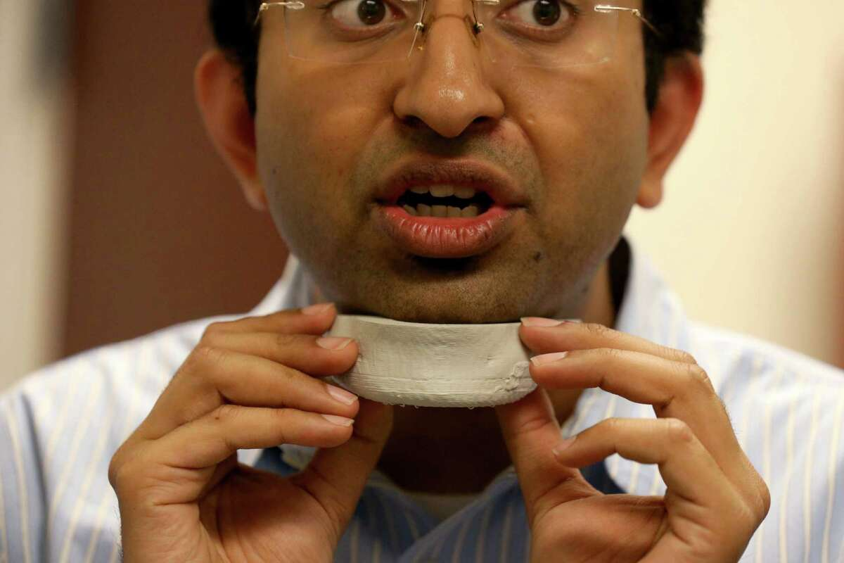 Teja Guda, assistant professor in the biomedical engineering department at the University of Texas at San Antonio, shows a 3D-printed silicone jawbone.