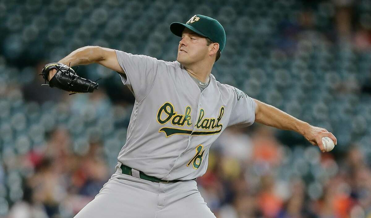 HOUSTON, TX - JULY 07: Rich Hill #18 of the Oakland Athletics pitches in the first inning against the Houston Astros at Minute Maid Park on July 7, 2016 in Houston, Texas. (Photo by Bob Levey/Getty Images)