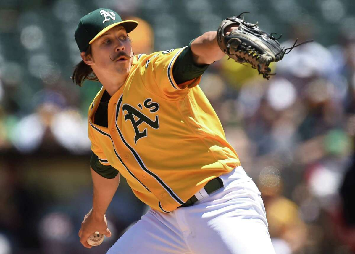 Oakland Athletics' Daniel Mengden (67) pitches against the Pittsburgh Pirates during the first inning on Sunday, July 3, 2016, at O.co Coliseum in Oakland, Calif. (Susan Tripp Pollard/Bay Area News Group/TNS)