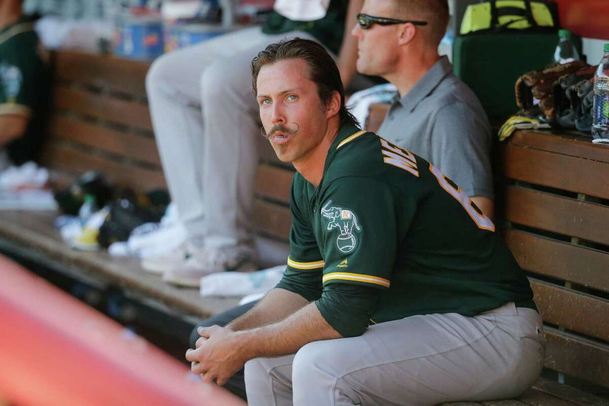 Oakland Athletics starting pitcher Daniel Mengden sits in the dugout after being relieved in the sixth inning of baseball game against the Cincinnati Reds, Saturday, June 11, 2016, in Cincinnati. The Reds won 2-1. (AP Photo/John Minchillo)