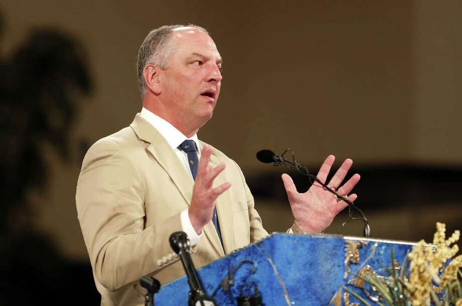 Louisiana Gov. John Bel Edwards participates in a prayer vigil for Alton Sterling, who was shot by Baton Rouge police in Baton Rouge, La., Thursday, July 7, 2016. Sterling, 37, was shot and killed outside the convenience store, where he was selling CDs. (AP Photo/Gerald Herbert) Photo: Gerald Herbert, STF / AP