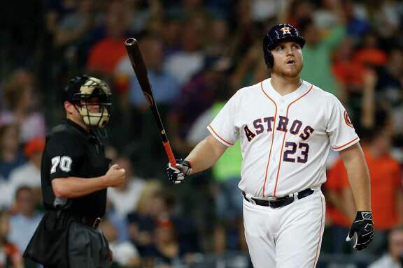 Houston Astros A.J. Reed (23) reacts after striking out during the seventh inning of an MLB baseball game at Minute Maid Park, Thursday, July 7, 2016, in Houston.