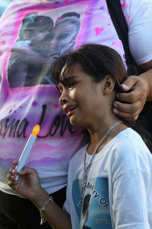 "Angela Colunga, 8, the cousin of Iris Rodriguez, the seven-year-old who was shot and killed last month on the West Side, is comforted by their grandmother, Josephine Juarez, during the City Wide Prayer Vigil ""Peace Over Violence"" held by Last Chance Ministries in front of City Hall in San Antonio on Thursday, July 7, 2016. Photo: Lisa Krantz / SAN ANTONIO EXPRESS-NEWS"