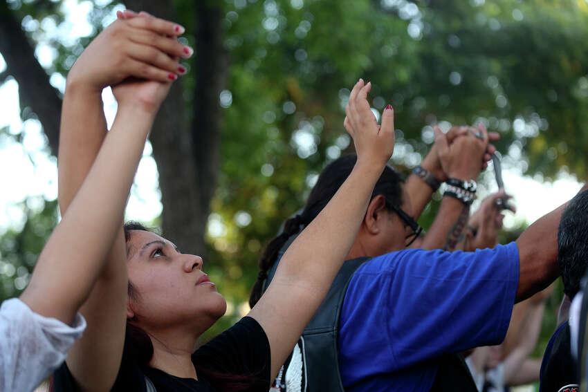Christina Luna, with Xtreme Harvest Church, prays during the City Wide Prayer Vigil