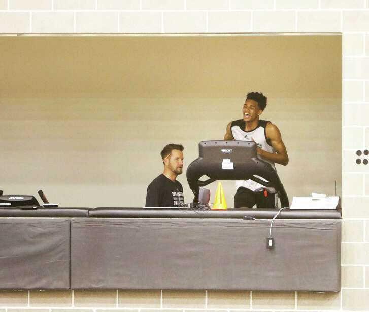 Spurs draft pick Dejounte Murray goes thru drills under the watchful eye of Kelly Forbes on Saturday, July 2, 2016 at the Spurs practice facility.