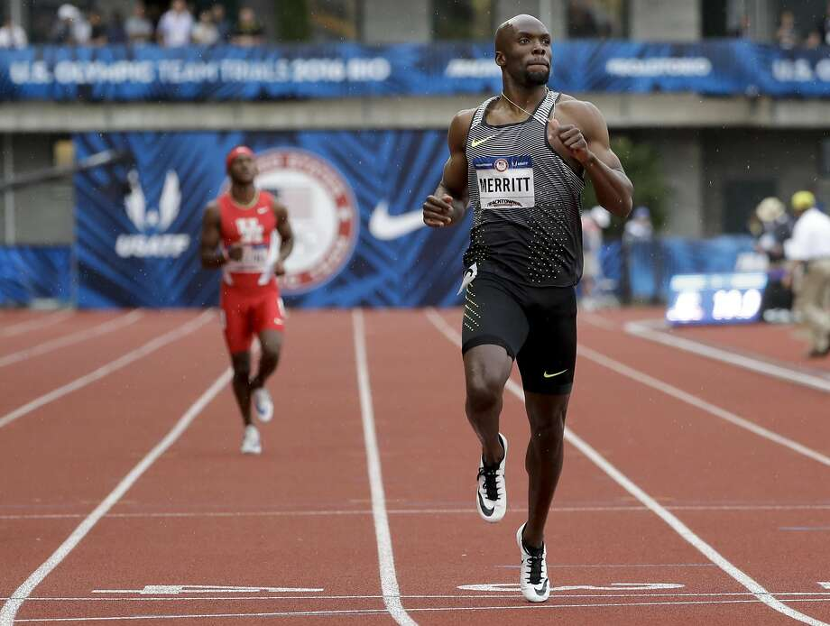 LaShawn Merritt finishes his heat with an easy victory in the men's 200-meter qualifier. Photo: Marcio Jose Sanchez, Associated Press
