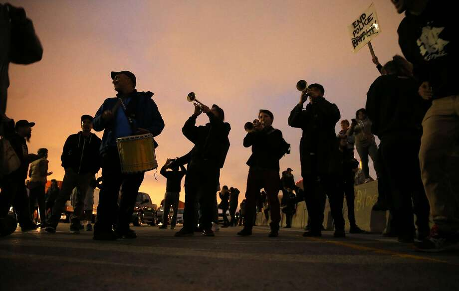 A band plays on I-880 after protesters against recent police shootings shut down the freeway in Oakland, Calif., on Thursday, July 7, 2016. Photo: Scott Strazzante, The Chronicle