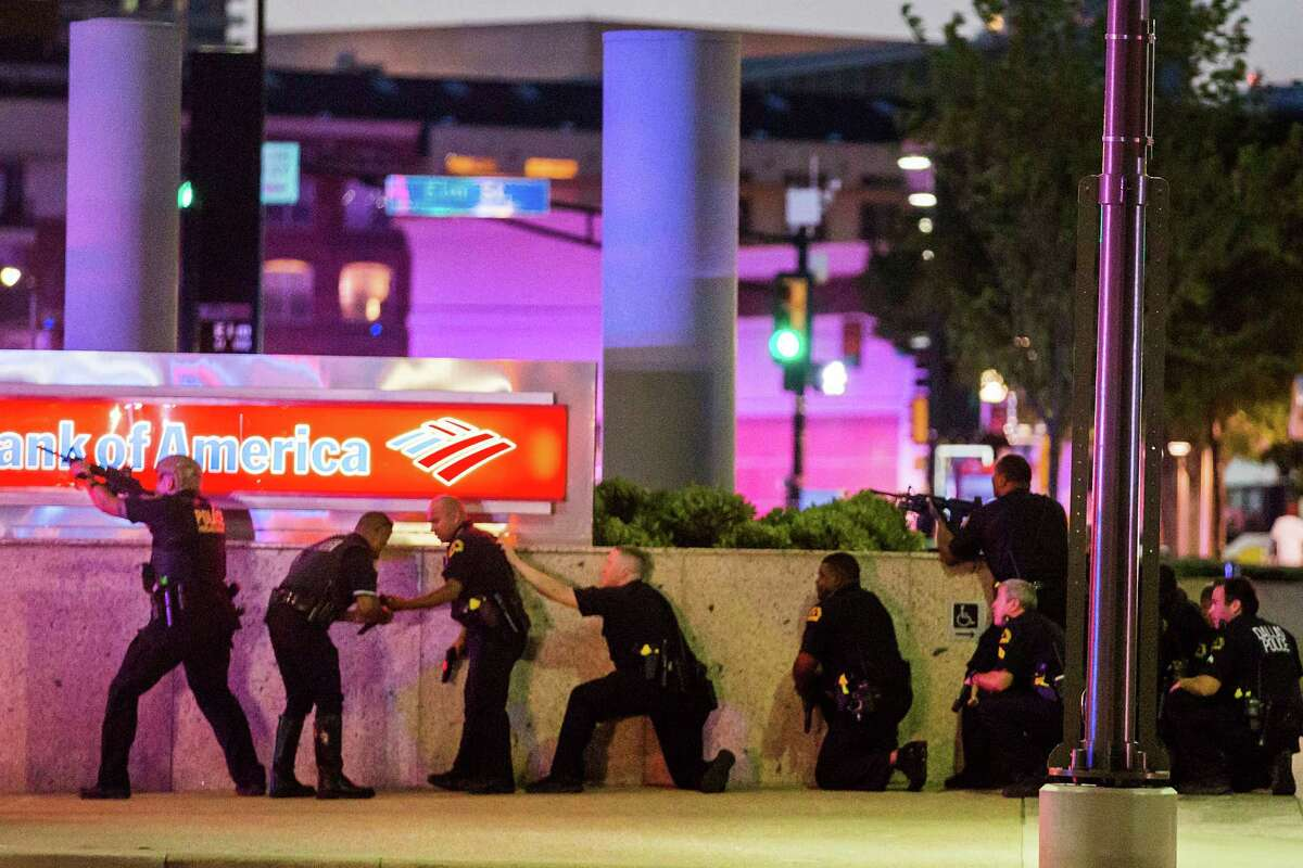 """Five police officers were fatally shot by two snipers at """"elevated positions"""" during peaceful protests held in downtown Dallas on Thursday night in response to recent police shootings involving black men in Baton Rouge, La. and St. Paul, Minn."""