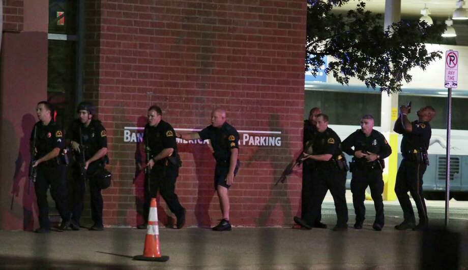 Dallas police respond after shots were fired  during a protest over recent fatal shootings by police in Louisiana and Minnesota, Thursday, July 7, 2016, in Dallas. Snipers opened fire on police officers during protests; several officers were killed, police said. (Maria R. Olivas/The Dallas Morning News via AP) Photo: Maria R. Olivas, Associated Press / THe Dallas Morning News