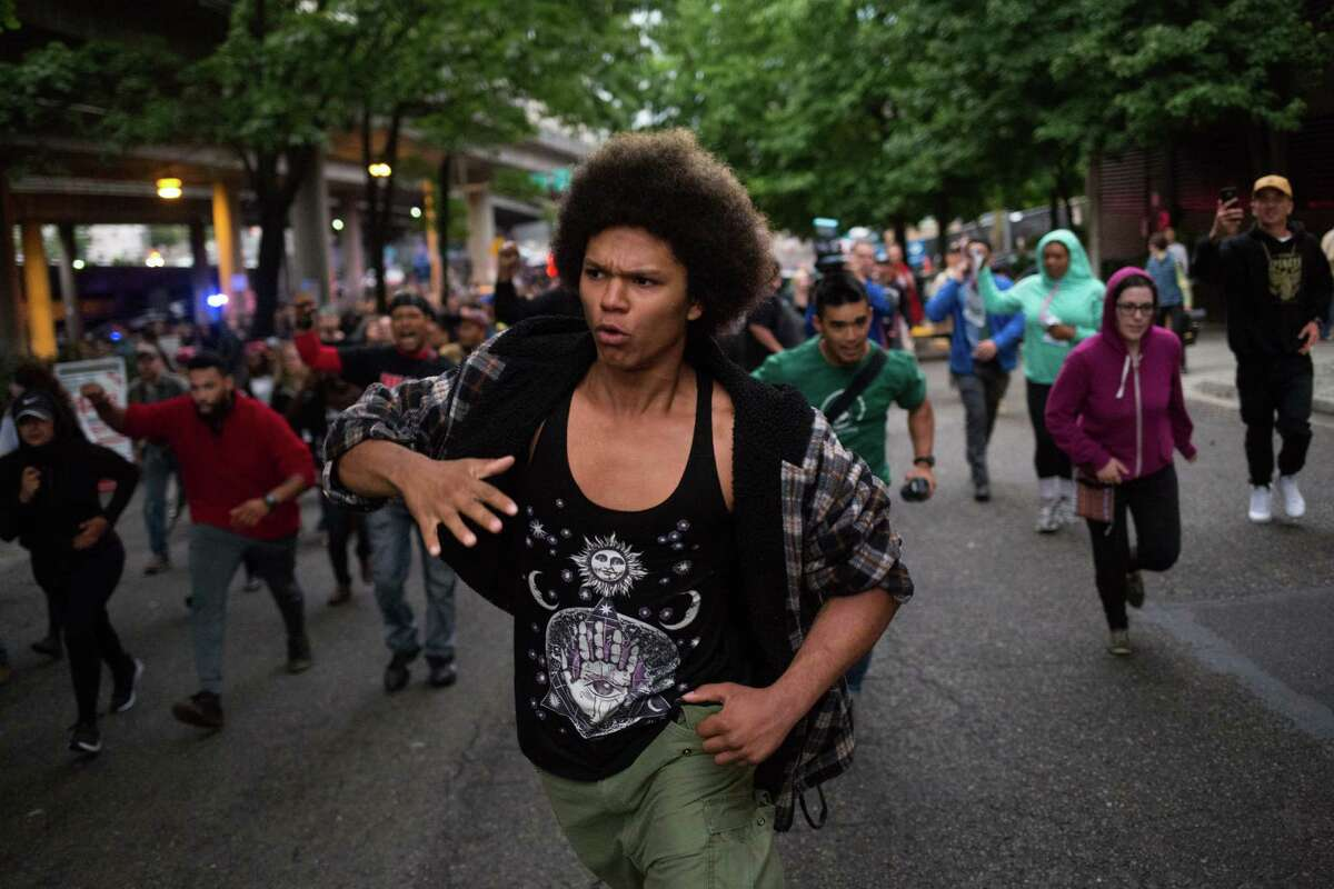 A leading protester moves the crowd towards I-5.