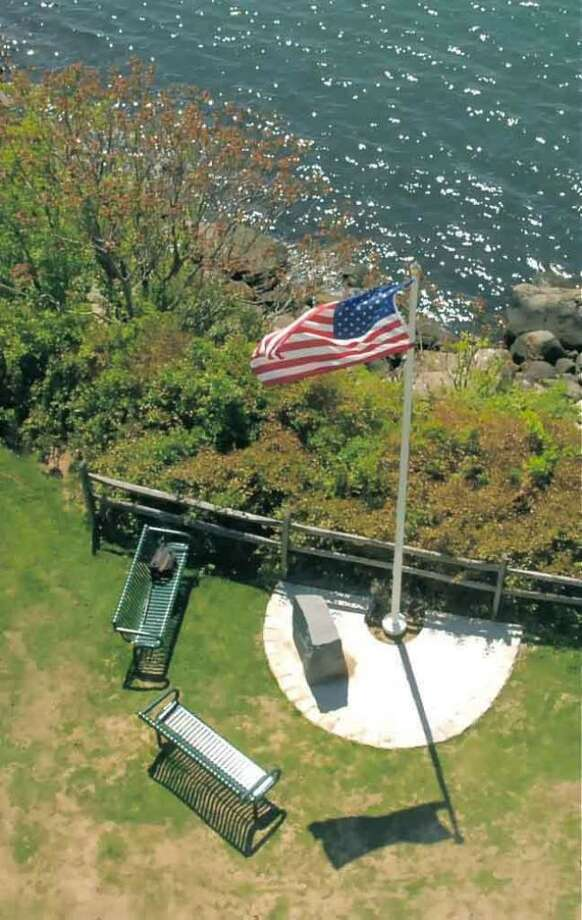The site of a memorial plaque next the lighthouse on Great Captains Island  dedicated to local victims of the Sept. 11, 2001, terrorist attacks. Photo: File Photo / Greenwich Time File Photo