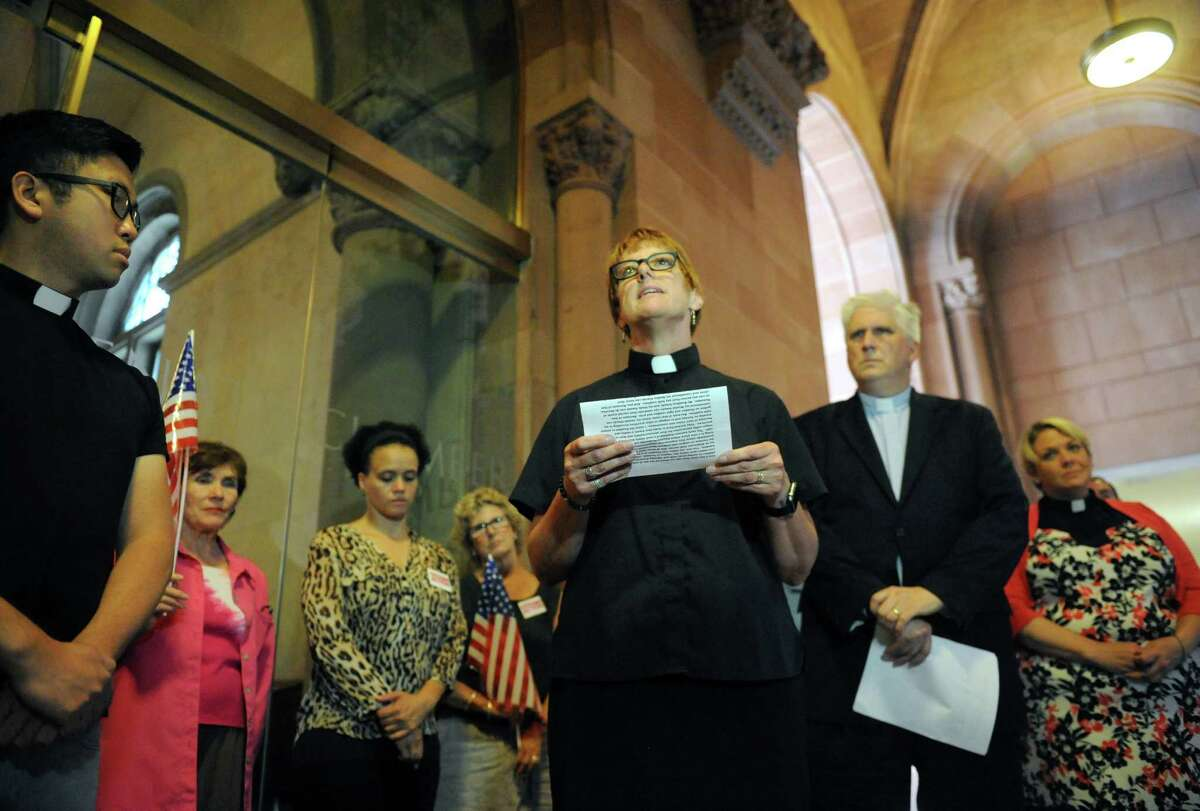 The Rev. Sandy Damhof of Journey United Church of Christ in Glenmont speaks at the state Capitol as clergy members denounce a Facebook page that criticizes Senate Democratic candidate Sara Niccoli for failing to recite the Pledge of Allegiance. Niccoli, who is running the 46th District against Republican incumbent George Amedore, is a Quaker who follows her beliefs that she should take no oath or pledge on Thursday July 7, 2016 in Albany, N.Y. (Michael P. Farrell/Times Union)