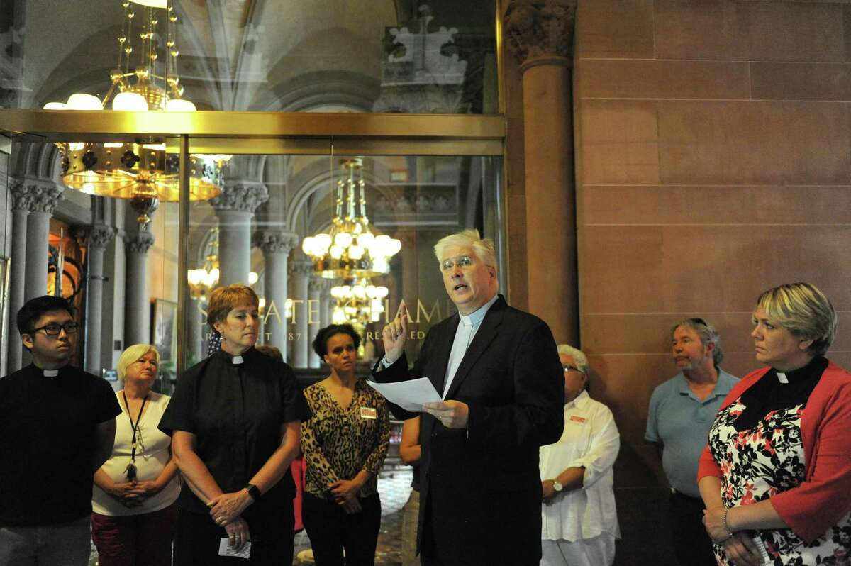 United Church of Christ Rev. Peter Cook speaks as clergy members denounce a Facebook page that hits Senate Democratic candidate Sara Niccoli for failing to speak the Pledge of Allegiance at the Capitol on Thursday July 7, 2016 in Albany, N.Y. (Michael P. Farrell/Times Union)