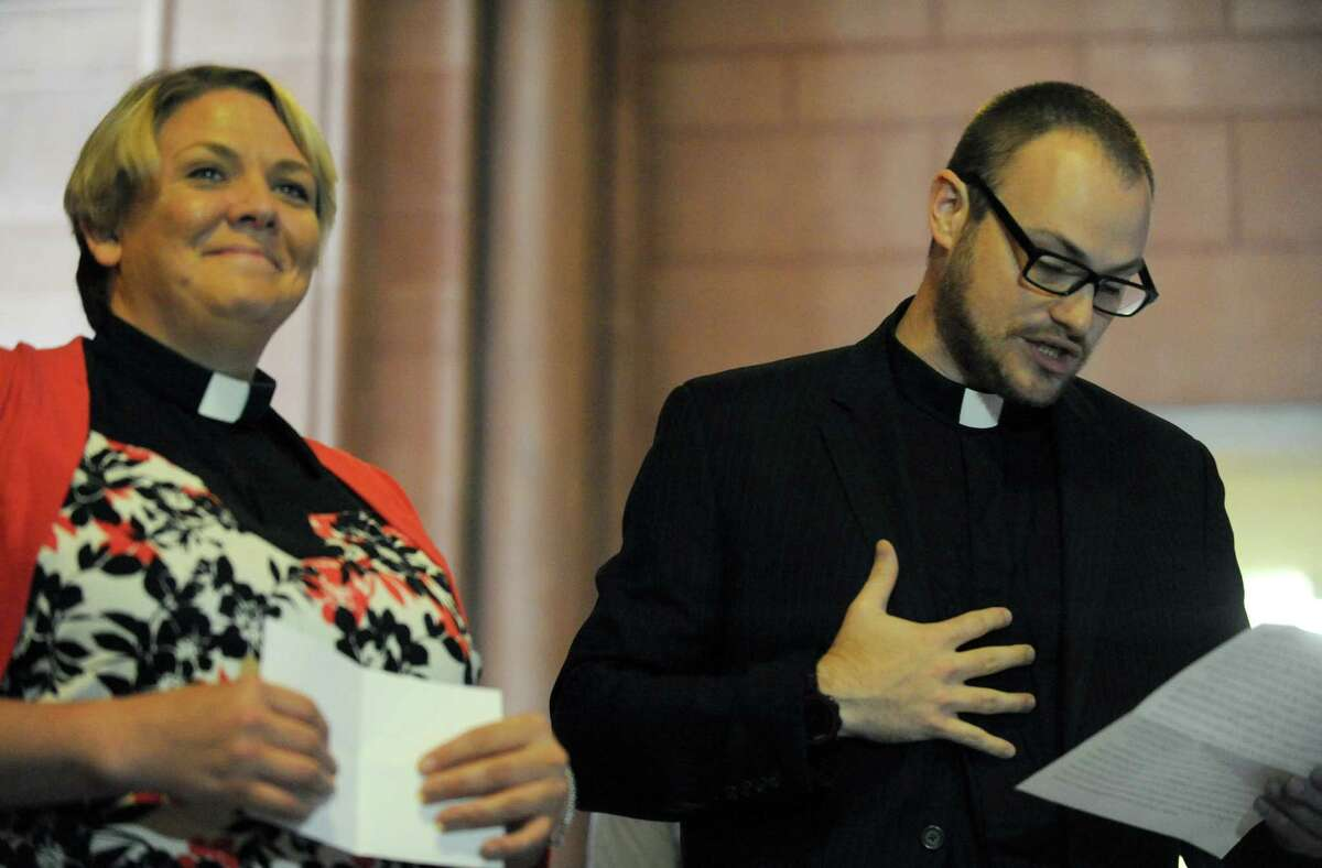 Rev. Stacey Midge, left, of the Reformed Church of America Schenectady and Rev. Dustin Wright of Messiah Lutheran Church of Rotterdam spak as clergy members denounce a Facebook page that hits Senate Democratic candidate Sara Niccoli for failing to speak the Pledge of Allegiance at the Capitol on Thursday July 7, 2016 in Albany, N.Y. (Michael P. Farrell/Times Union)