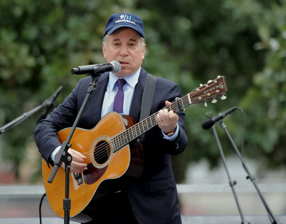 "Paul Simon performs ""The Sound of Silence"" in this file photo taken in New York City. Photo: STAN HONDA / AFP / Getty Images / AFP or licensors"