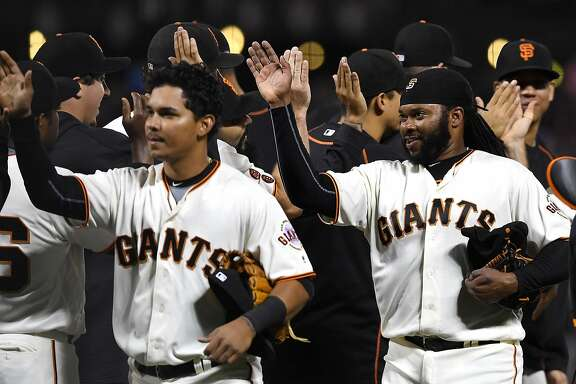 SAN FRANCISCO, CA - JULY 06:  Johnny Cueto #47 of the San Francisco Giants (R) and his teammates celebrates defeating the Colorado Rockies 5-1 at AT&T Park on July 6, 2016 in San Francisco, California.  (Photo by Thearon W. Henderson/Getty Images)