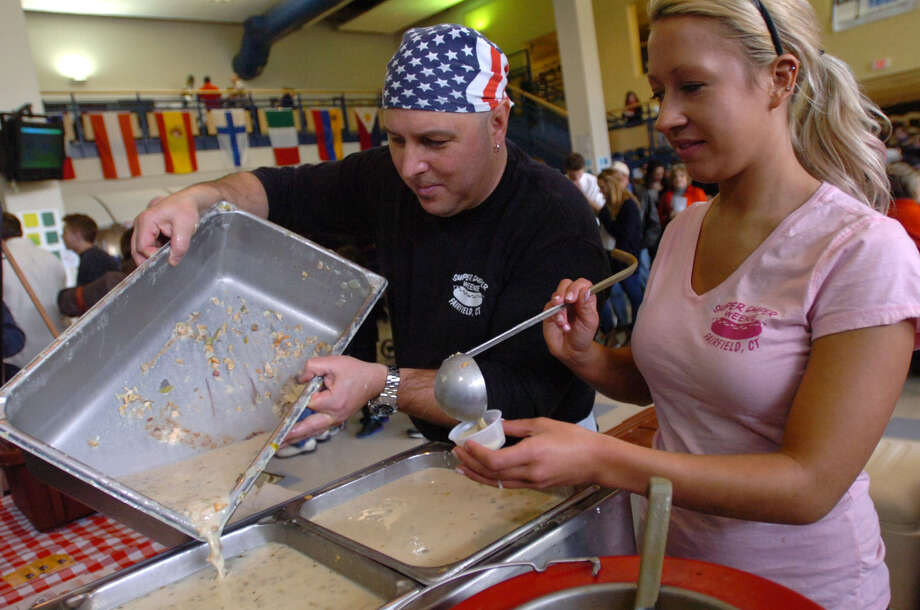 Gary and Katie Radovic of Super Duper Weenie serve up clam chowder during the Westport's Chowdafest to benefit the Connecticut Food Bank. Photo: Erik Trautmann / Hearst Connecticut Media / (C)2011, The Hour Newspapers, all rights reserved