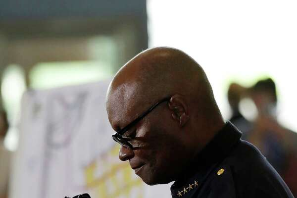 Dallas police chief David Brown pauses during a news conference, Friday, July 8, 2016, in Dallas. Snipers opened fire on police officers in the heart of Dallas Thursday night, during protests over two recent fatal police shootings of black men.