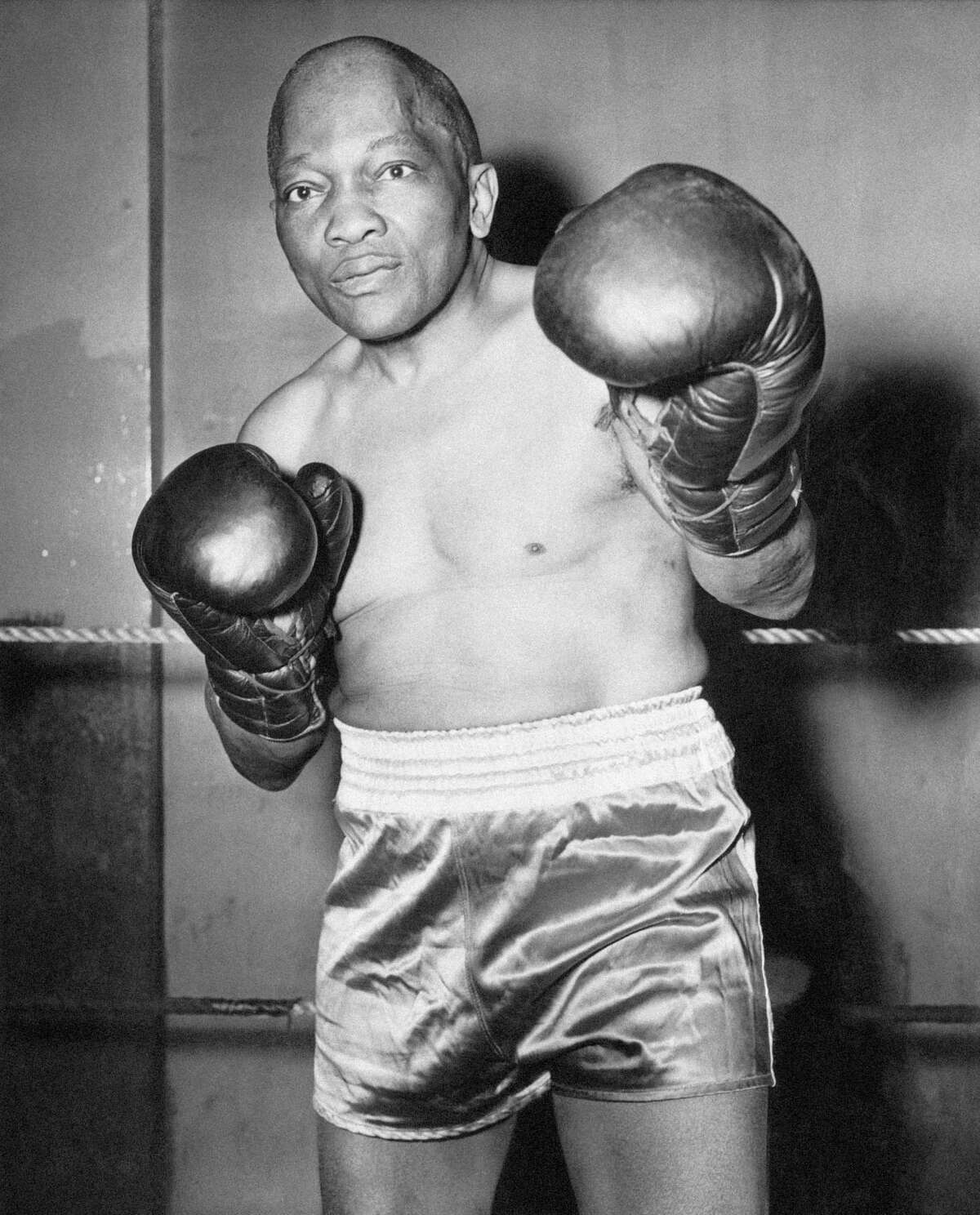 Jack Johnson, 67, prepares for an exhibition at a war bond show in New York City on May 1945. Along with making public appearances, Johnson also performed on Broadway during his retirement.