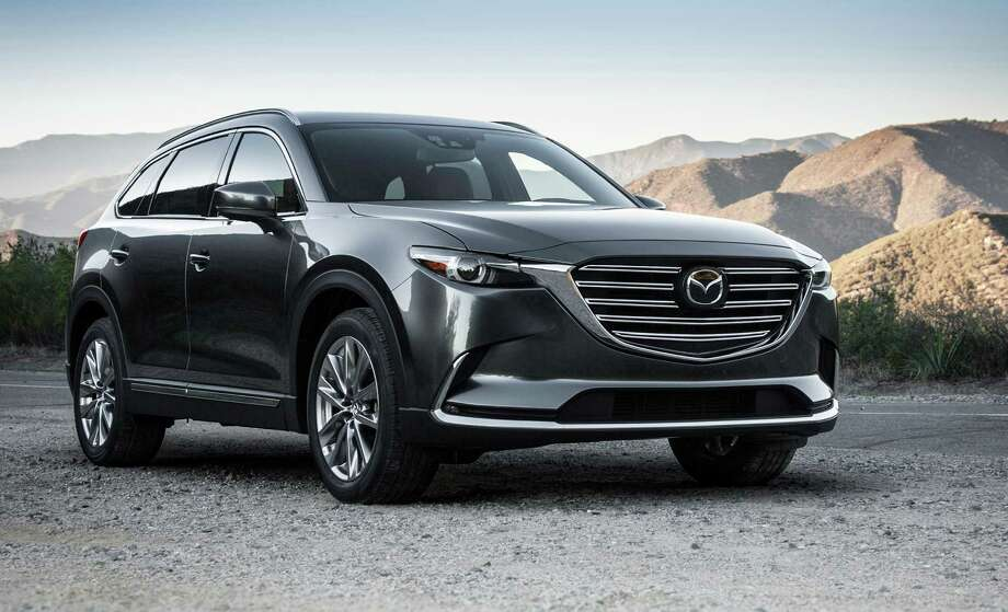 The 2016 CX-9's new turbocharged four-cylinder engine improved the EPA estimated fuel economy to 22 miles per gallon city and 28 mpg highway for the front-wheel-drive Mazda crossover. The all-wheel-drive versions came in at 21 and 27 mpg, respectively. Photo: Mazda / 2015