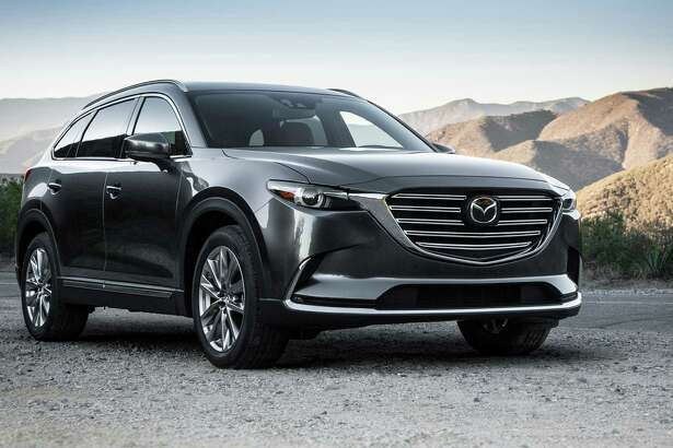 The 2016 CX-9's new turbocharged four-cylinder engine improved the EPA estimated fuel economy to 22 miles per gallon city and 28 mpg highway for the front-wheel-drive Mazda crossover. The all-wheel-drive versions came in at 21 and 27 mpg, respectively.
