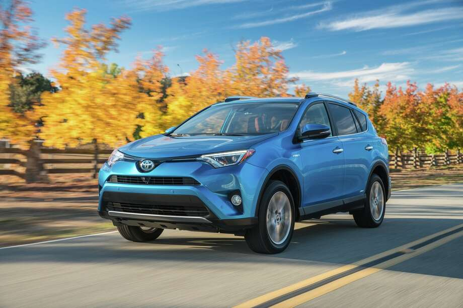 The 2016 Toyota RAV4 comes in new Hybrid XLE and Limited models. All 2016 RAV4 models feature refreshed exterior styling, providing a sleeker, more dynamic appearance. Photo: Toyota / dewhurstphoto