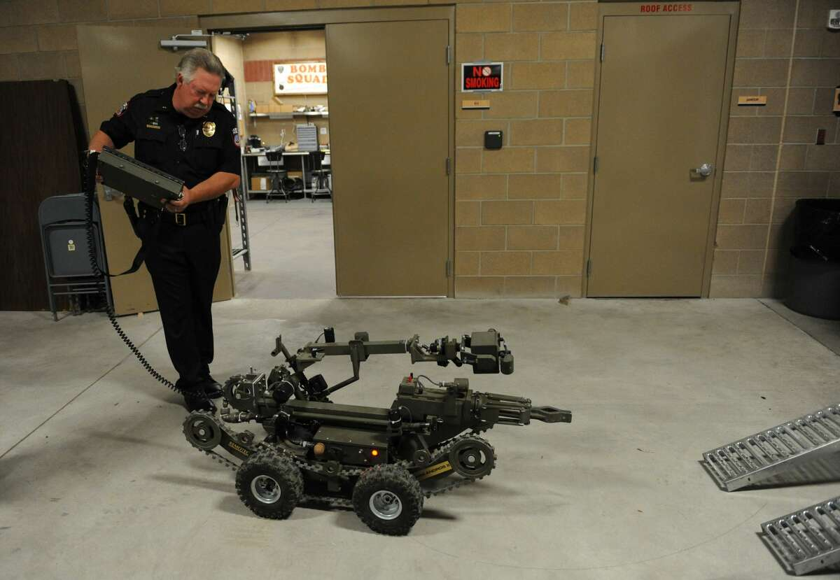 """Police killed a suspect in the shootings, 25-year-old Micah Johnson, by remote detonation of a bomb in the El Centro College parking lot downtown where he had been cornered, potentially the first time a robot has been used by law enforcement to kill a suspect. Authorities said negotiators had tried to get the man to surrender, and that he said he was upset about the recent police shootings and """"wanted to kill white people, especially white officers."""""""