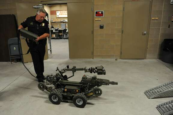 Pueblo Police Deputy Chief Andrew McLachlan shows off one of two bomb robots, Monday June, 27, 2011, used in the department. Pueblo using homeland security funds bought the two bomb robots in one day. RJ Sangosti, The Denver Post  (Photo By RJ Sangosti/The Denver Post via Getty Images)