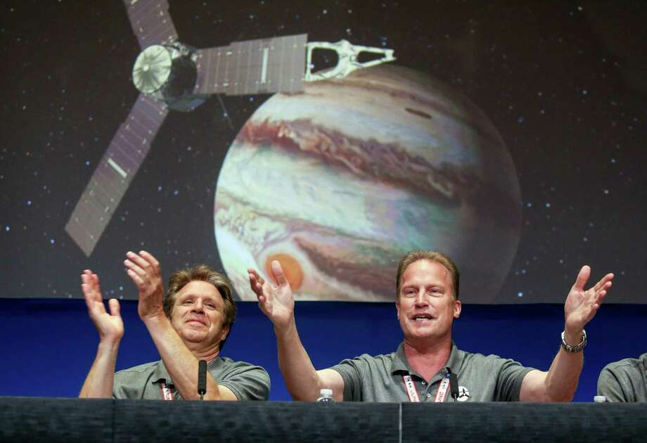 Scott Bolton (left) and Rick Nybakken react at NASA's Jet Propulsion Laboratory after the solar-powered Juno spacecraft entered orbit around Jupiter on Monday. For now, we'll focus on Juno and Kevin Durant; there will be time for that other stuff after Labor Day as the general election nears. Photo: Ringo H.W. Chiu / Associated Press / FR170512 AP